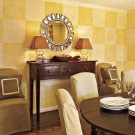 dining area with delicate coated checkerboard walls