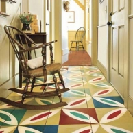 entryway with painted patchwork tile floor