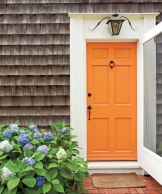 front home painted bright tangerine, foolproof staging tips from designers