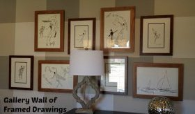 Gallery Wall of Framed Drawings in Study