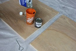 Mixing paint slimmer into stain for a DIY wall surface art task