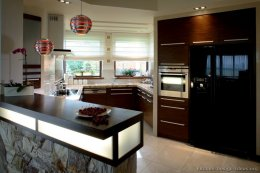 Modern Angular Kitchen with Exotic Wood and Extraordinary Pendant Lights