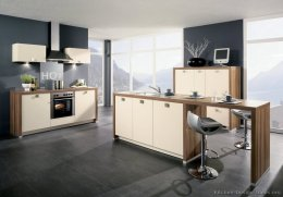 Modern Kitchen Design with Cool Gray Floors and heated Toned Cabinets