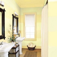 small bathroom coated with pale-green and yellow stripes