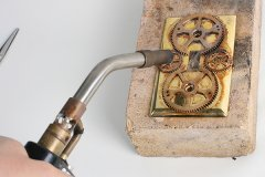 Soldering metal with a torch - Steampunk Decor