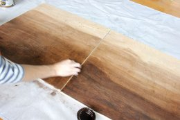 with the thinned stain, start slowly working the stain within the lumber because of this Do-it-yourself wall art project